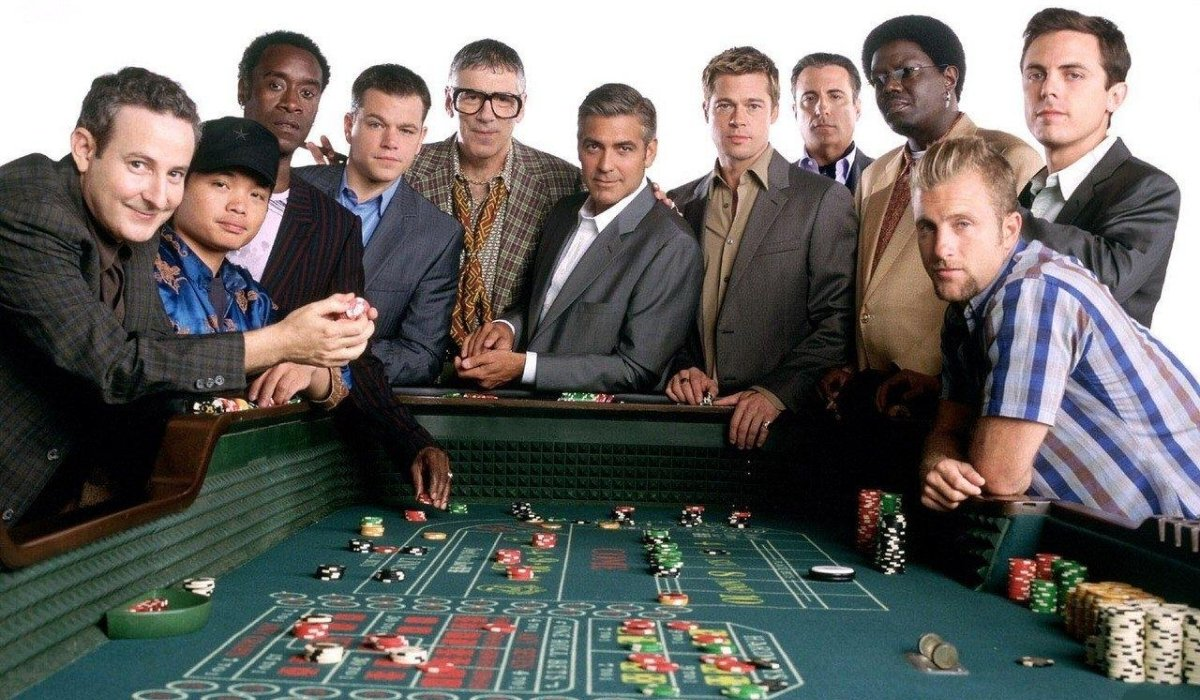 Ocean's Thirteen the entire gang crowds around a Craps table