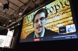 Edward Snowden speaks via videoconference during the 2014 SXSW Music, Film + Interactive Festival in Austin, Texas.