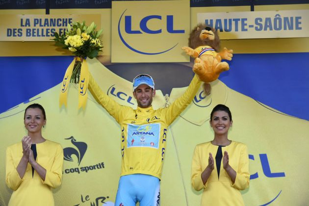 Vincenzo Nibali on the podium after winning Stage 10 of the 2014 Tour de France and regaining the yellow jersey.