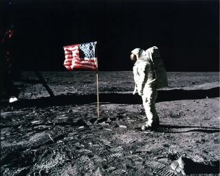 Buzz Aldrin salutes the U.S. flag on the surface of the moon during the Apollo 11 mission on July 20, 1969. Some conspiracy theorists believe that NASA faked the landing.