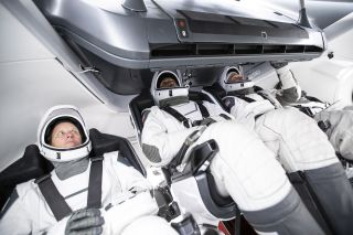 The four astronauts that will fly on SpaceX's Crew-1 mission to the International Space Station train for their spaceflight inside a Crew Dragon mockup.