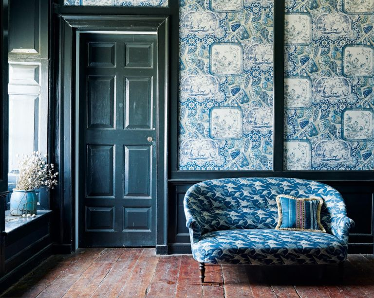 Blue small sofa with swallows, blue patterned wallpaper by Mulberry Home