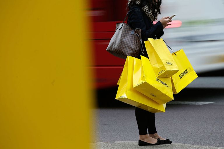 Selfridges Black Friday: A woman carries shopping bags from Selfridges