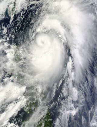 Typhoon Mawar was spotted churning over the Philippine Sea by a NASA satellite June 3.