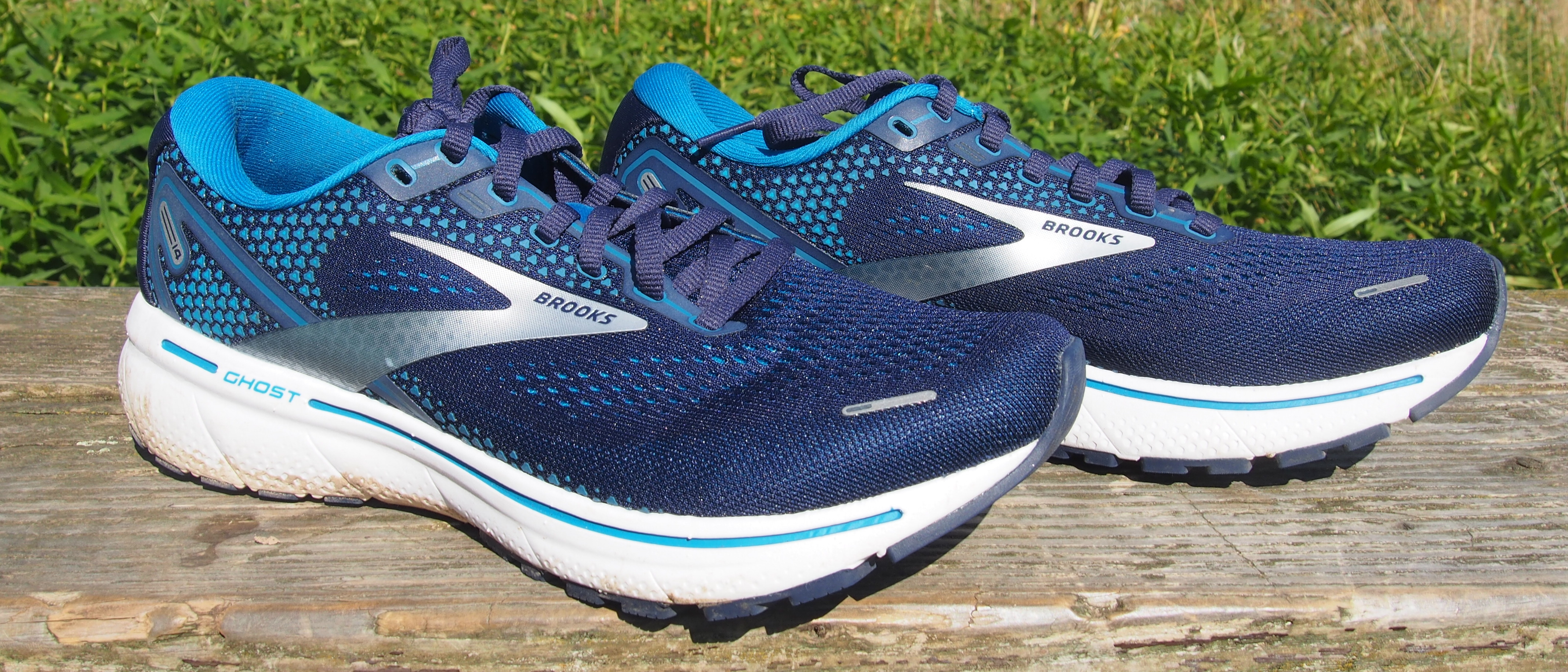 Pair of Brooks Ghost 14 running shoes, viewed from the side