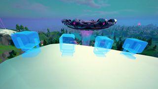 Fortnite alien light communication devices on mountain tops