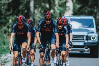 Chris Froome and Geraint Thomas riding in the new Ineos Grenadiers kit