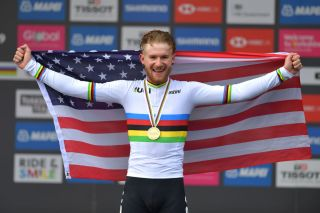 The USA's Quinn Simmons celebrates having won the junior men's road race at the 2019 UCI Road World Championships in Yorkshire