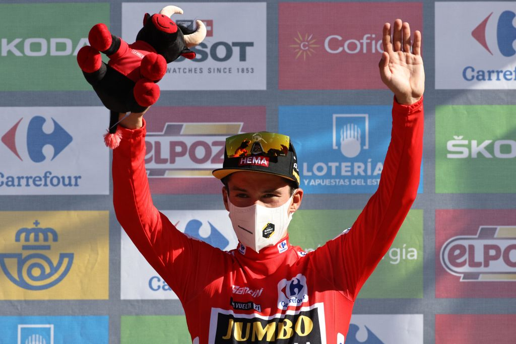 Team Jumbos Slovenian rider Primoz Roglic celebrates on the podium retaining the overall leaders red jersey after the 7th stage of the 2021 La Vuelta cycling tour of Spain a 152 km race from Gandia to Balcon de Alicante in Tibi on August 20 2021 Photo by JOSE JORDAN AFP Photo by JOSE JORDANAFP via Getty Images