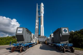 A United Launch Alliance Atlas V rocket carrying the U.S. military's Advanced Extremely High Frequency 4 communications satellite moves to the launchpad ahead of an Oct. 17, 2018, liftoff.