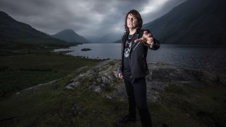 a shot of joey tempest stood on a moody hillside