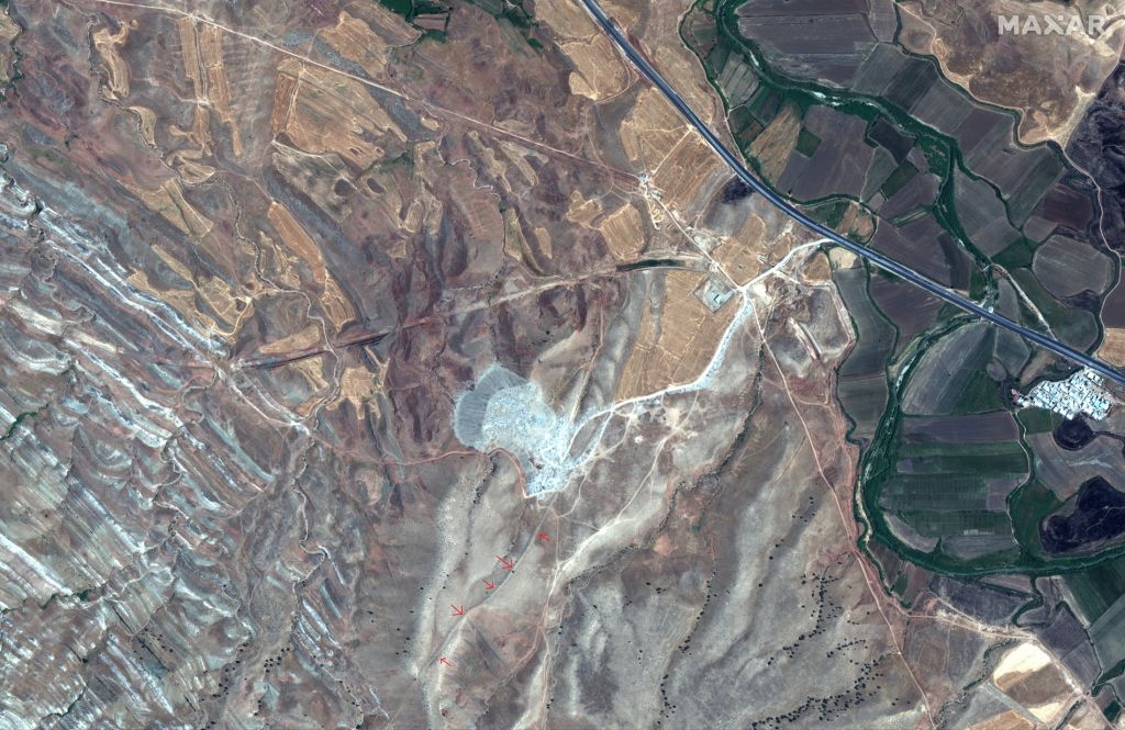 This satellite image was taken on July 31, 2019 by the WorldView-2 satellite. The red arrows show a surviving section of the Gawri Wall.