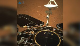 This photo is the first color view of Mars from China's Zhurong rover, looking toward its rear, from its landing spot on a plain in Utopia Planitia following a May 14, 2021 landing. This image was released May 19.