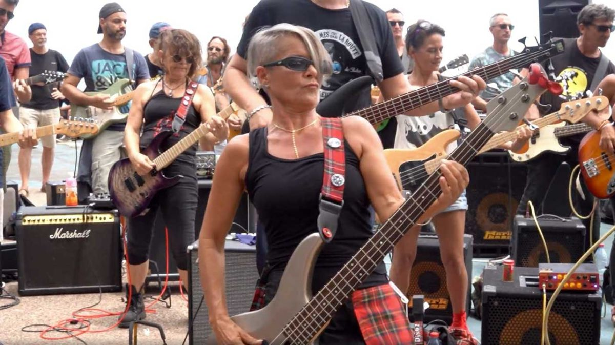 Watch 100 musicians play AC/DC's T.N.T. on the tropical island of Reunion