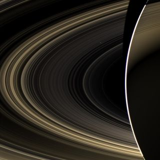 Venus Peeks Through Saturn's Rings