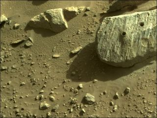 """NASA's Perseverance rover has collected two drilled-out samples from this Red Planet rock, which the mission team dubbed """"Rochette."""""""