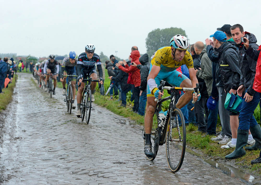 Vincenzo Nibali powers over the cobbles near Brillon in northern France during stage five of the Tour de France. His bike handling skills over the mud and rain-covered pavé helped him place third on the stage and stay in yellow.