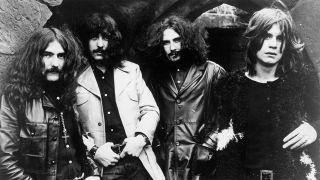 Black Sabbath standing in a line