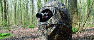 Photographer in a portable hide
