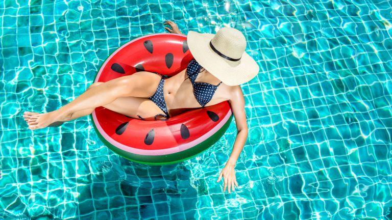 Pool, woman in pool, Airbnb, Swimply, pool rental app, woman on watermelon pool float