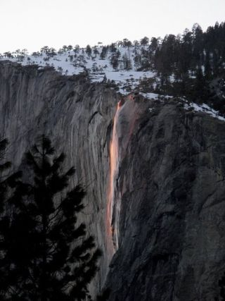 Yosemite National Park's Horsetail Falls lit up by the sun's rays