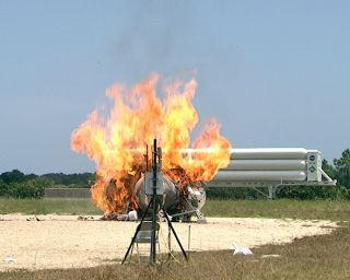 NASA's Morpheus lander prototype in flames.