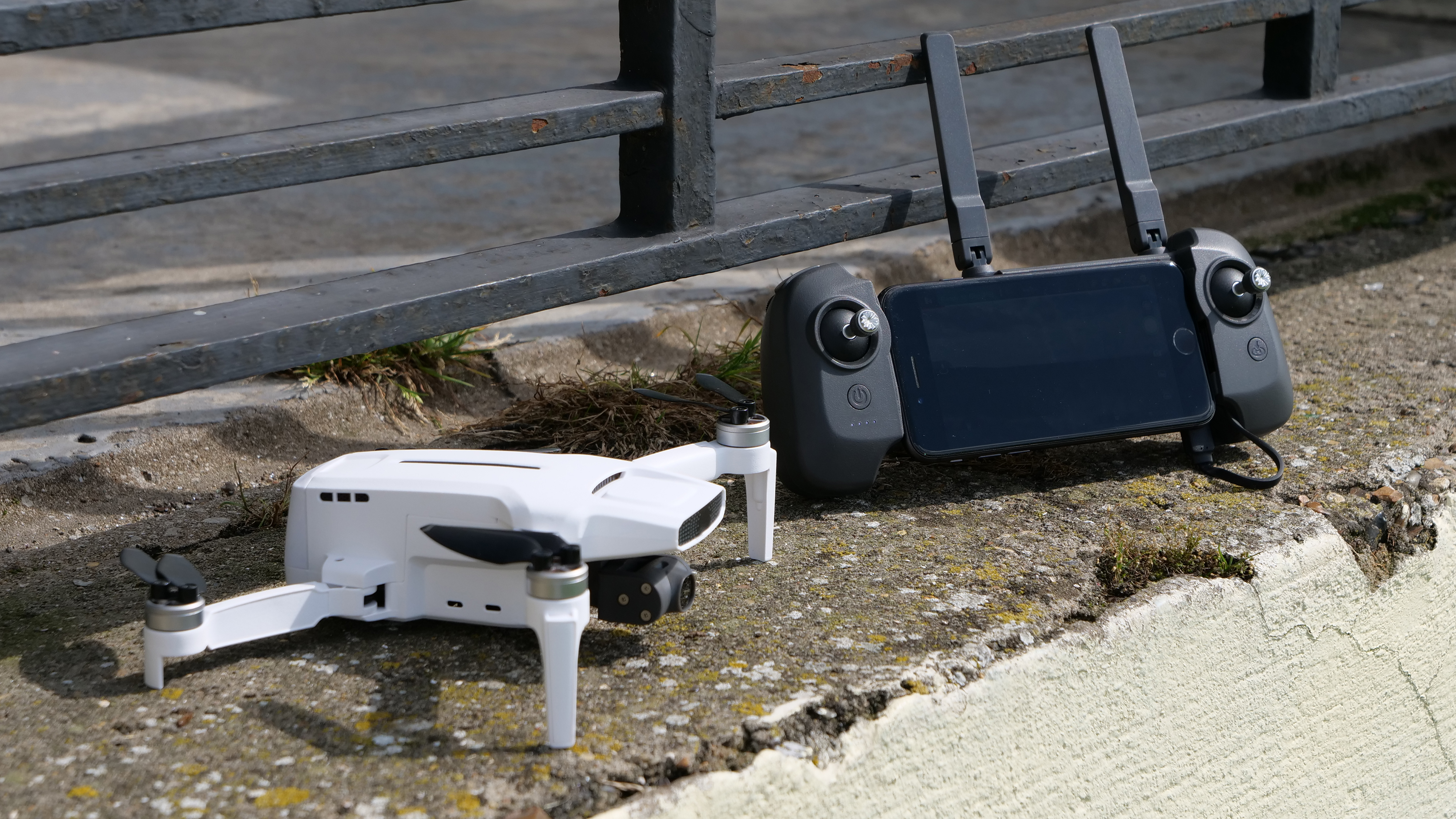 The FIMI X8 Mini drone next to its controller