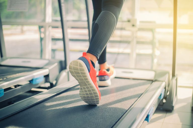 woman on the best treadmill in her home