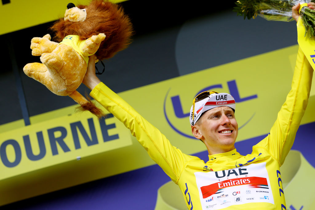 LIBOURNE FRANCE JULY 16 Tadej Pogaar of Slovenia and UAETeam Emirates yellow leader jersey celebrates at podium during the 108th Tour de France 2021 Stage 19 a 207km stage from Mourenx to Libourne Lion Mascot LeTour TDF2021 on July 16 2021 in Libourne France Photo by Tim de WaeleGetty Images