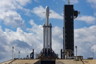 SpaceX's Falcon Heavy rocket, topped with the Arabsat-6A communications satellite, sits on the launch pad on April 10, 2019.