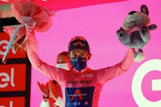 Overall leader Ineos Grenadiers rider Egan Bernal celebrates on the podium stage 12 of the Giro d'Italia 2021