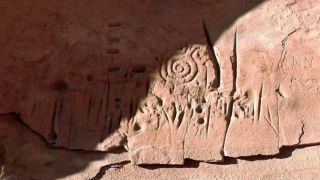 The spiral patterns that appear prominently in the rock carvings are thought to be a symbol among ancestral Pueblo peoples for the sky or the sun.