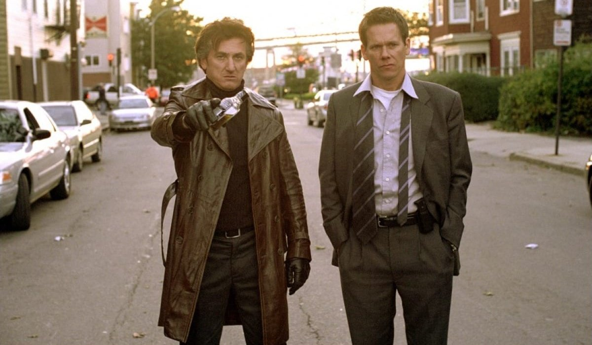 Sean Penn laments with Kevin Bacon on the streets of Boston in Mystic River.