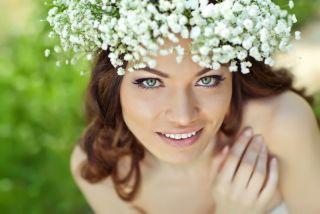 pretty woman wearing flower head crown