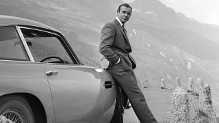 """Sean Connery with the iconic Aston Martin DB5 in """"Goldfinger"""" in 1964."""