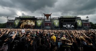 A photograph of the stage and crowd at Wacken