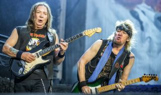 Dave Murray (left) and Adrian Smith perform with Iron Maiden at the Sweden Rock Festival 2018