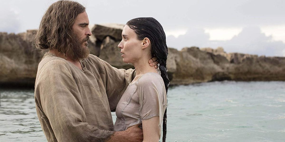 Mary Magdalene Joaquin Phoenix and Rooney Mara embracing in the water