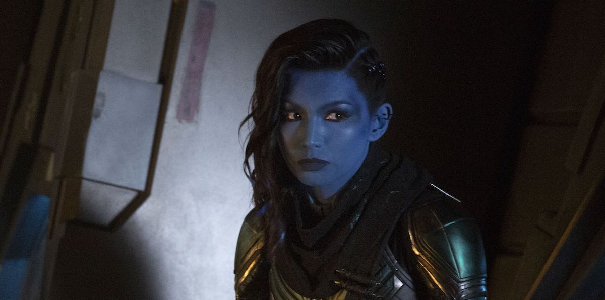 Minn-Erva (Gemma Chan) sits in the shadows in a scene from 'Captain Marvel'