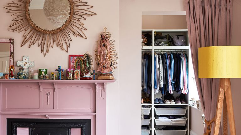 Pink bedroom with fireplace and organized walk in closet