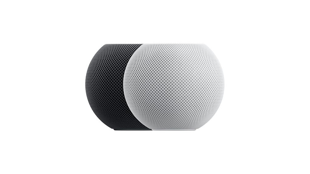 two apple homepod mini smart speakers; one in gray, and one in white