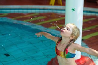 Girl spitting in pool