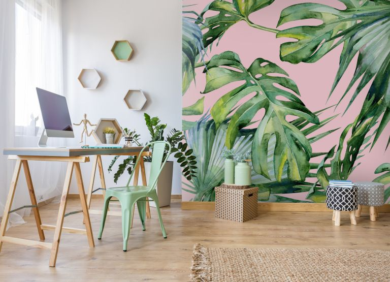 best fibre broadband deal: pink and tropicla feature wall in an office with more simplistic, scandi style furniture