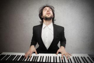 man in tuxedo playing piano