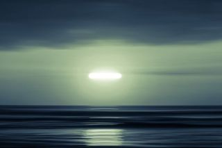 Two aircraft reported seeing a bright green UFO over Canada in July 2021.