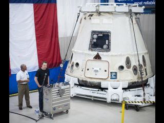 NASA chief Charlie Bolden and SpaceX CEO Elon Musk with the history-making Dragon capsule