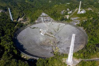 This aerial view shows the damage at the Arecibo Observatory after one of the main cables holding the receiver broke in Arecibo, Puerto Rico, on December 1, 2020.