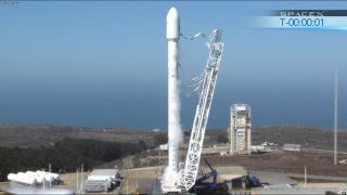 SpaceX's new upgraded Falcon 9 rocket undergoes an static fire engine test on Sept. 19, 2013 ahead of a Sept. 29 launch testfrom Vandenberg Air Force Base in California.