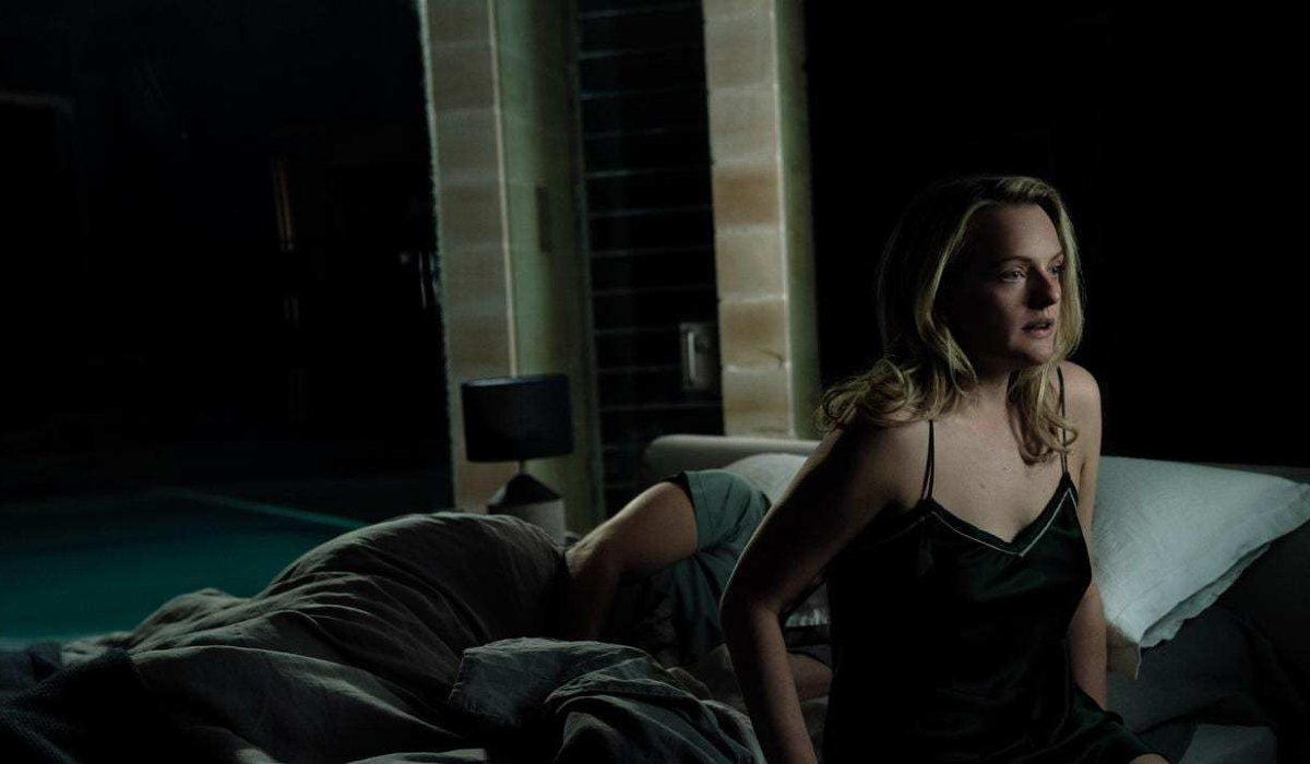 The Invisible Man Elizabeth Moss sits at the edge of her bed