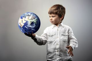 A young boy with a globe.